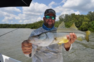 Capt. Jason of Chasing Tails Charters Catching snook on his day off