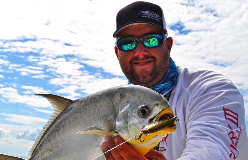 Tampa Fishing Guide Jason Dozier holding a Permit